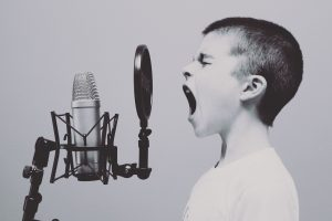 Child singing into a Microphone